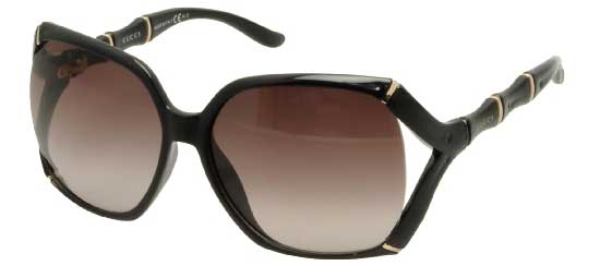 Side of Gucci shiny black and brown sunglasses